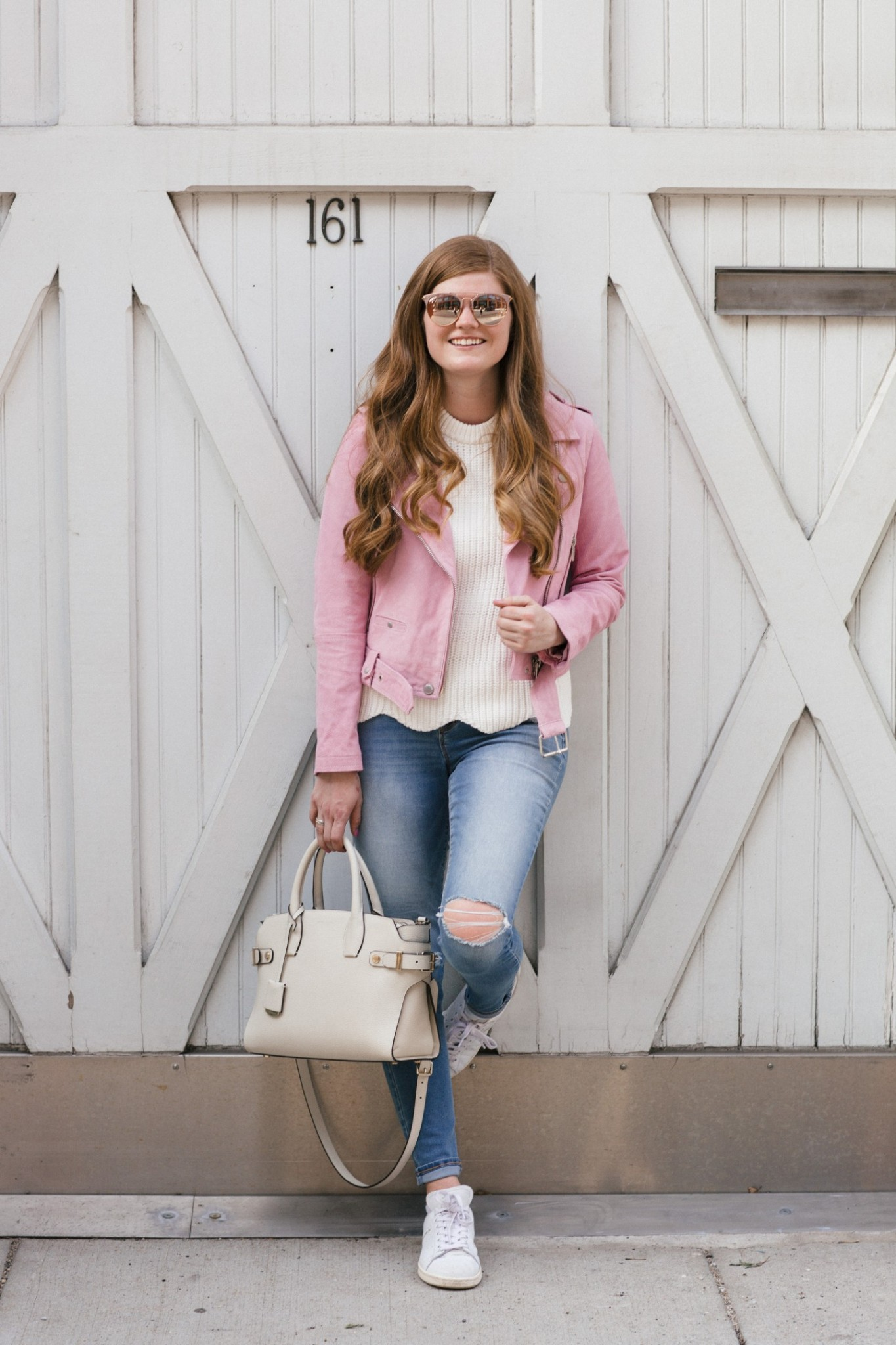 Lifestyle blogger Mollie Sheperdson styles a pink moto jacket for spring