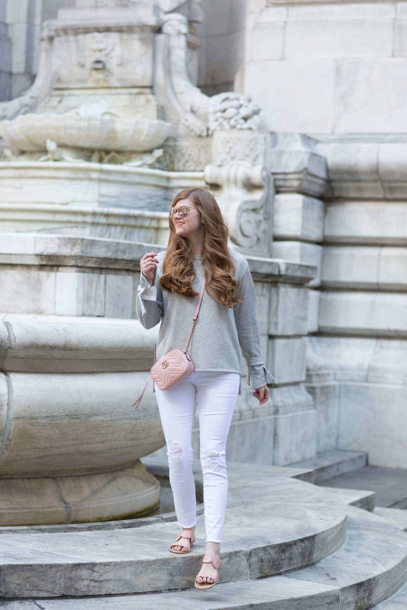 Lifestyle blogger Mollie Sheperdson styles a grey tie sleeve sweatshirt