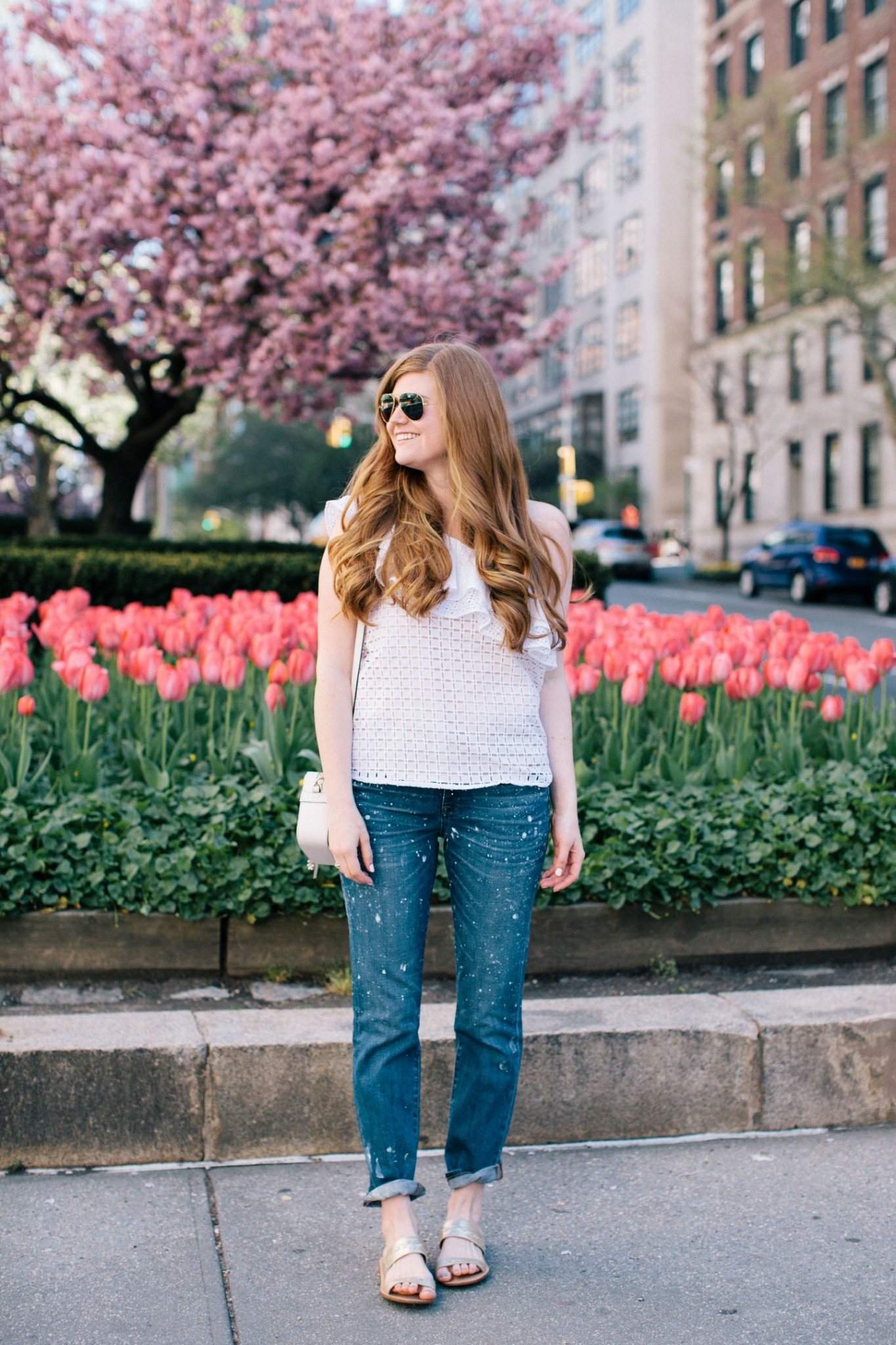 Lifestyle blogger Mollie Sheperdson in front of the Park Avenue Tulips