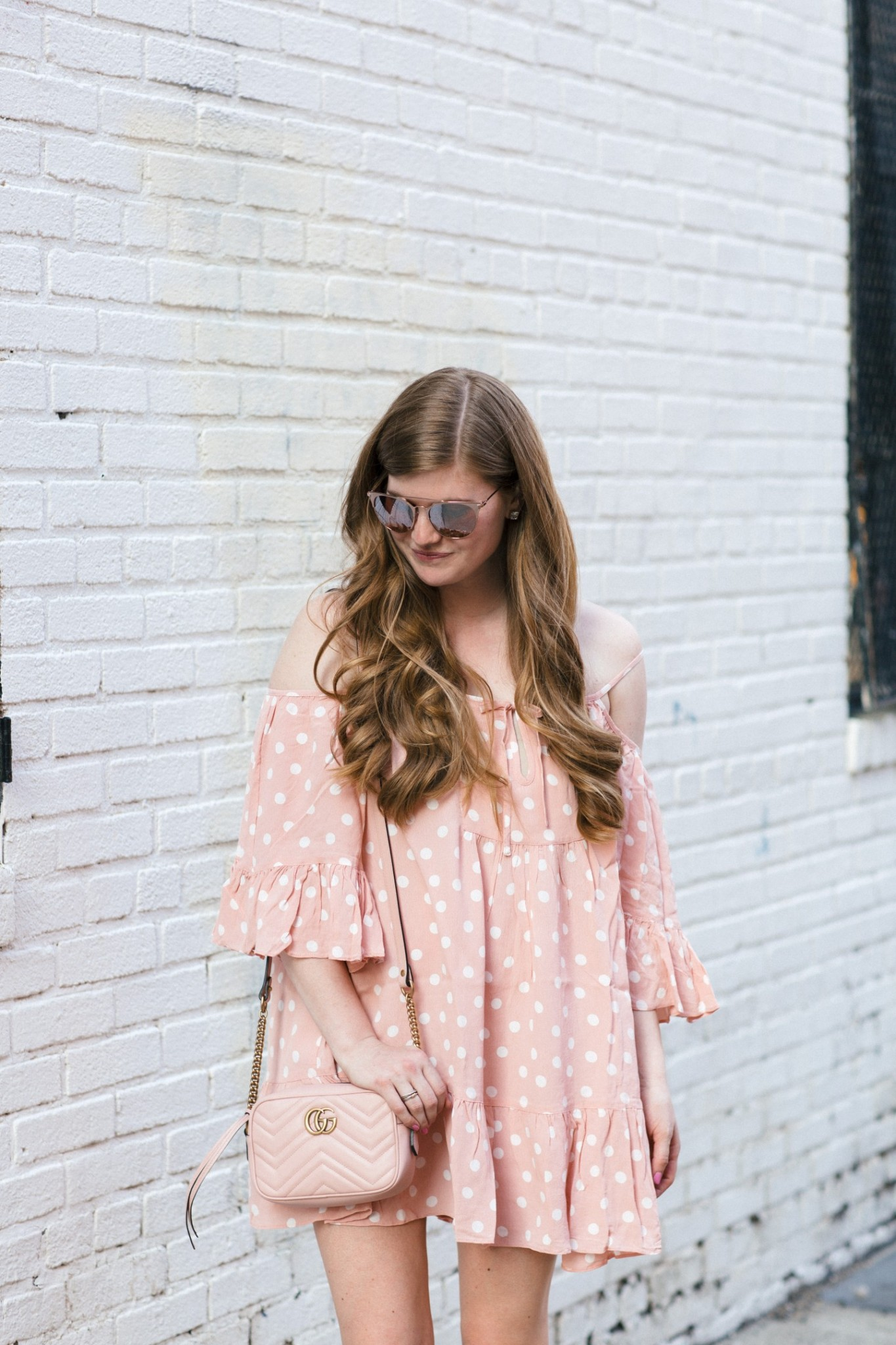Lifestyle blogger Mollie Sheperdson styles a pink polka dot dress