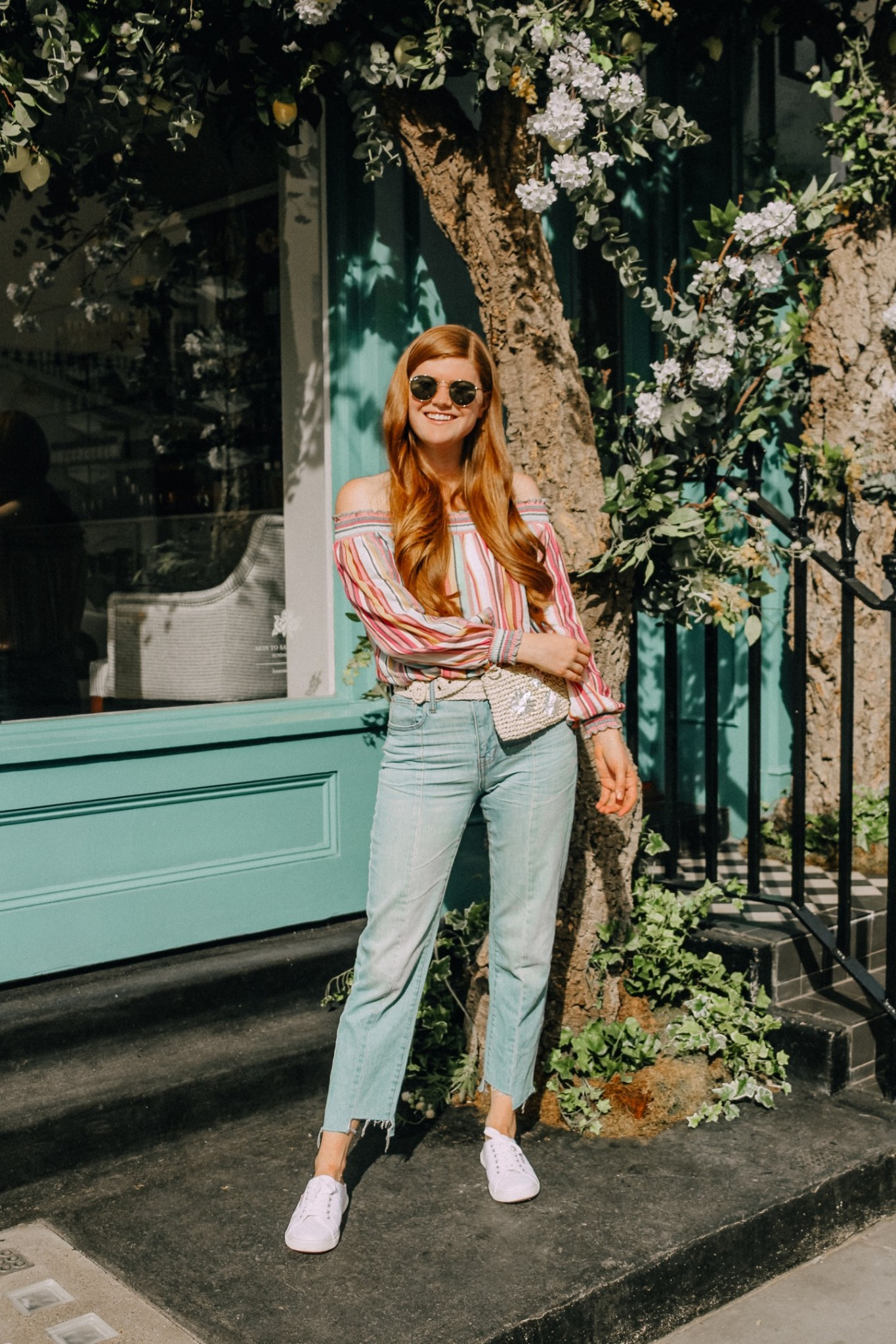 Lifestyle blogger Mollie Moore shares tips on how to style a belt bag