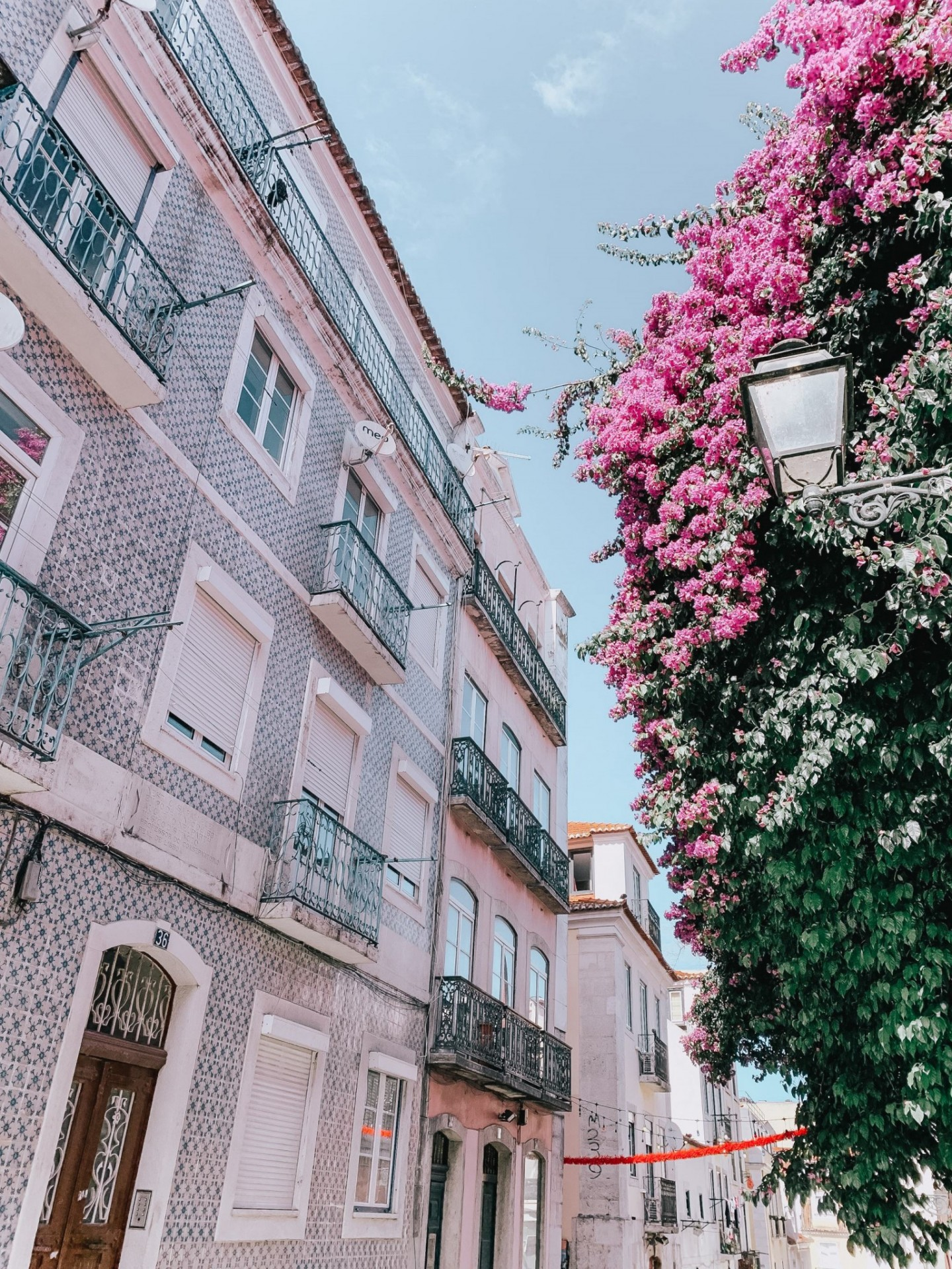 Lifestyle blogger Mollie Moore shares a Lisbon travel guide | Visiting Portugal: The Ultimate Lisbon Travel Guide & the Best Things to Do by popular London travel blogger, Mollie Moore: image of a tiled building in Lisbon, Portugal.