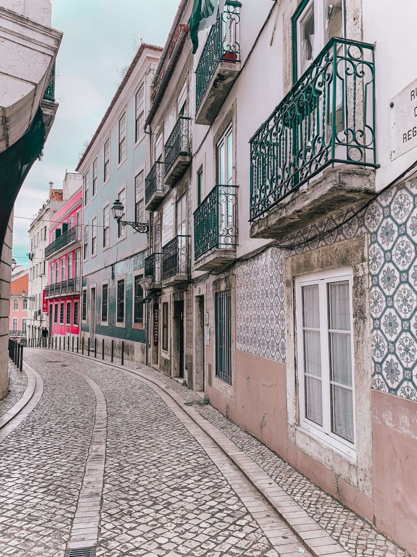 Lifestyle blogger Mollie Moore shares a Lisbon travel guide | Visiting Portugal: The Ultimate Lisbon Travel Guide & the Best Things to Do by popular London travel blogger, Mollie Moore: image of colorful buildings in Lisbon, Portugal.