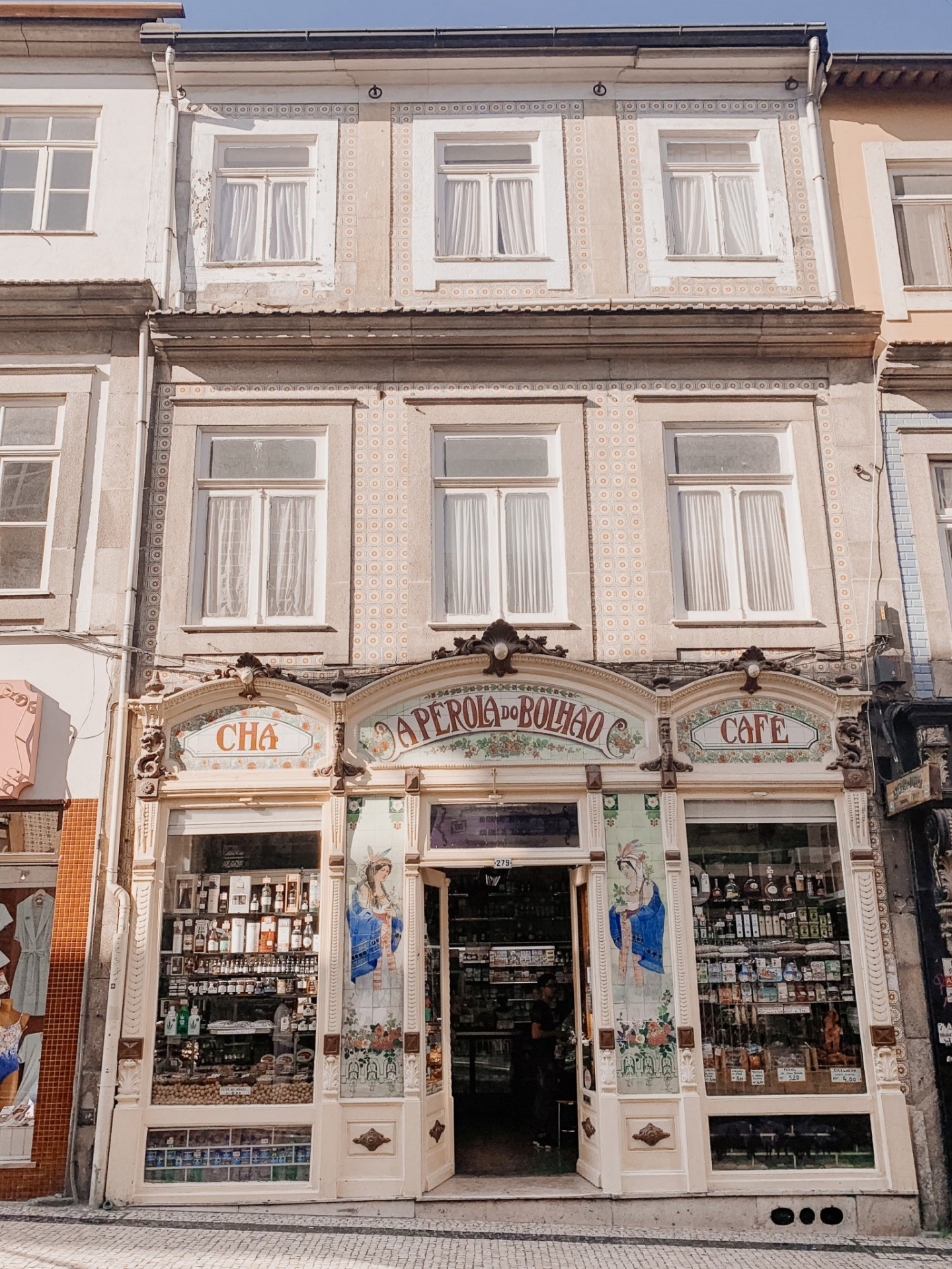 Lifestyle blogger Mollie Moore shares a Porto travel guide | A Porto Portugal Travel Guide by popular Great Britain international travel blogger, Mollie Moore: image of Aperola do Bolhao Cafe in Porto Portugal.