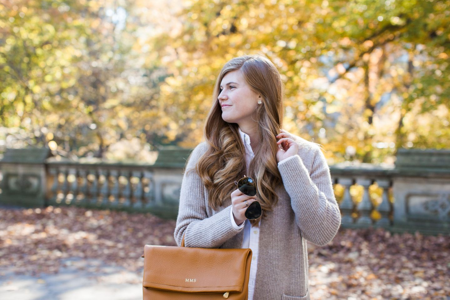 Lifestyle blogger Mollie Sheperdson wears a Madewell sweater and GiGi New York backpack