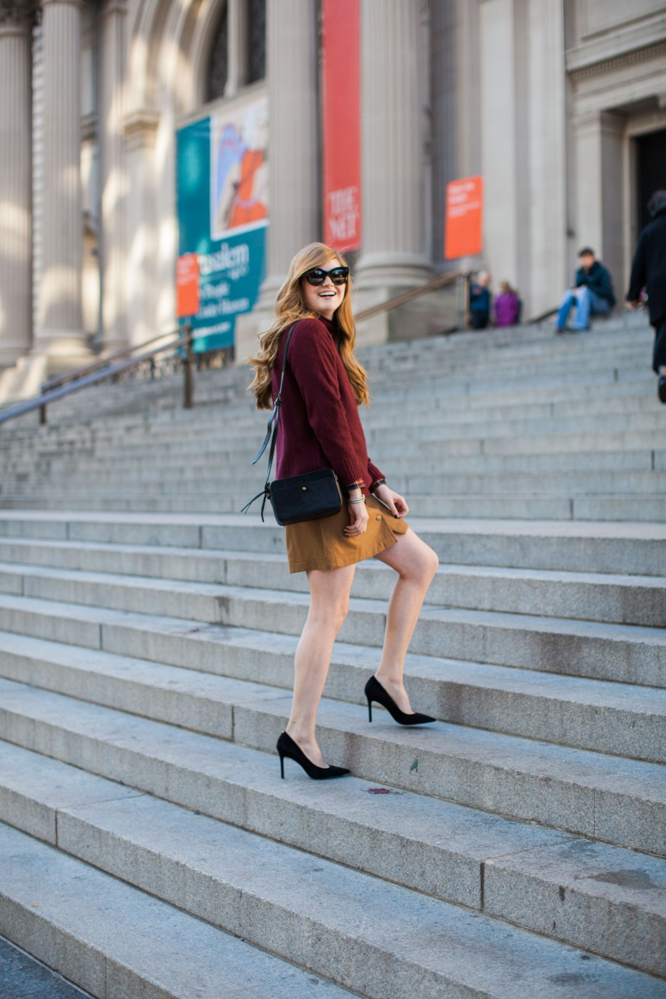Lifestyle blogger Mollie Sheperdson wears a Madewell holiday outfit at the Metropolitan Museum of Art
