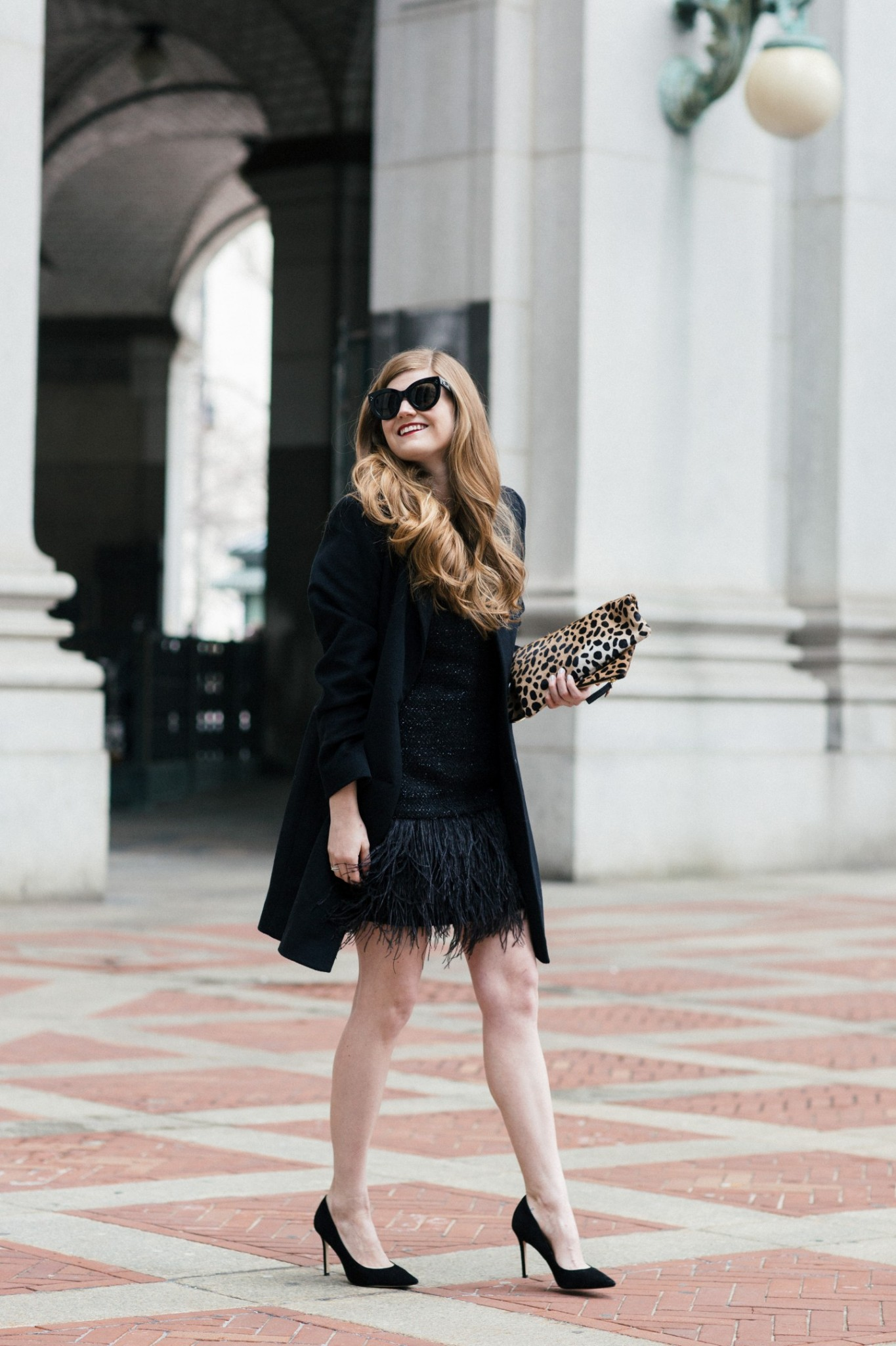 Lifestyle blogger Mollie Sheperdson shares a fun and feathery New Years Eve outfit