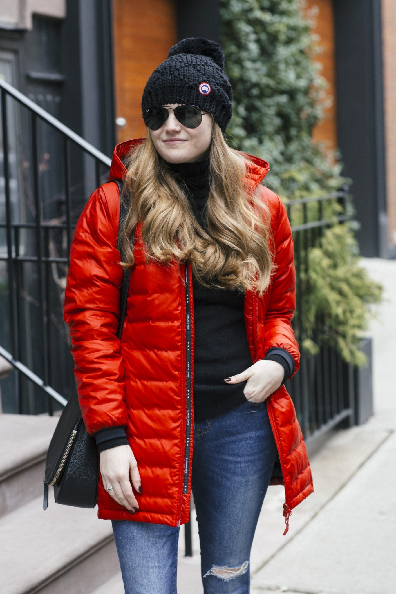 Lifestyle blogger Mollie Sheperdson wearing the Canada Goose Camp Down Parka | The Best Winter Coats for Warmer Winters featured by top London fashion blog, Mollie Moore