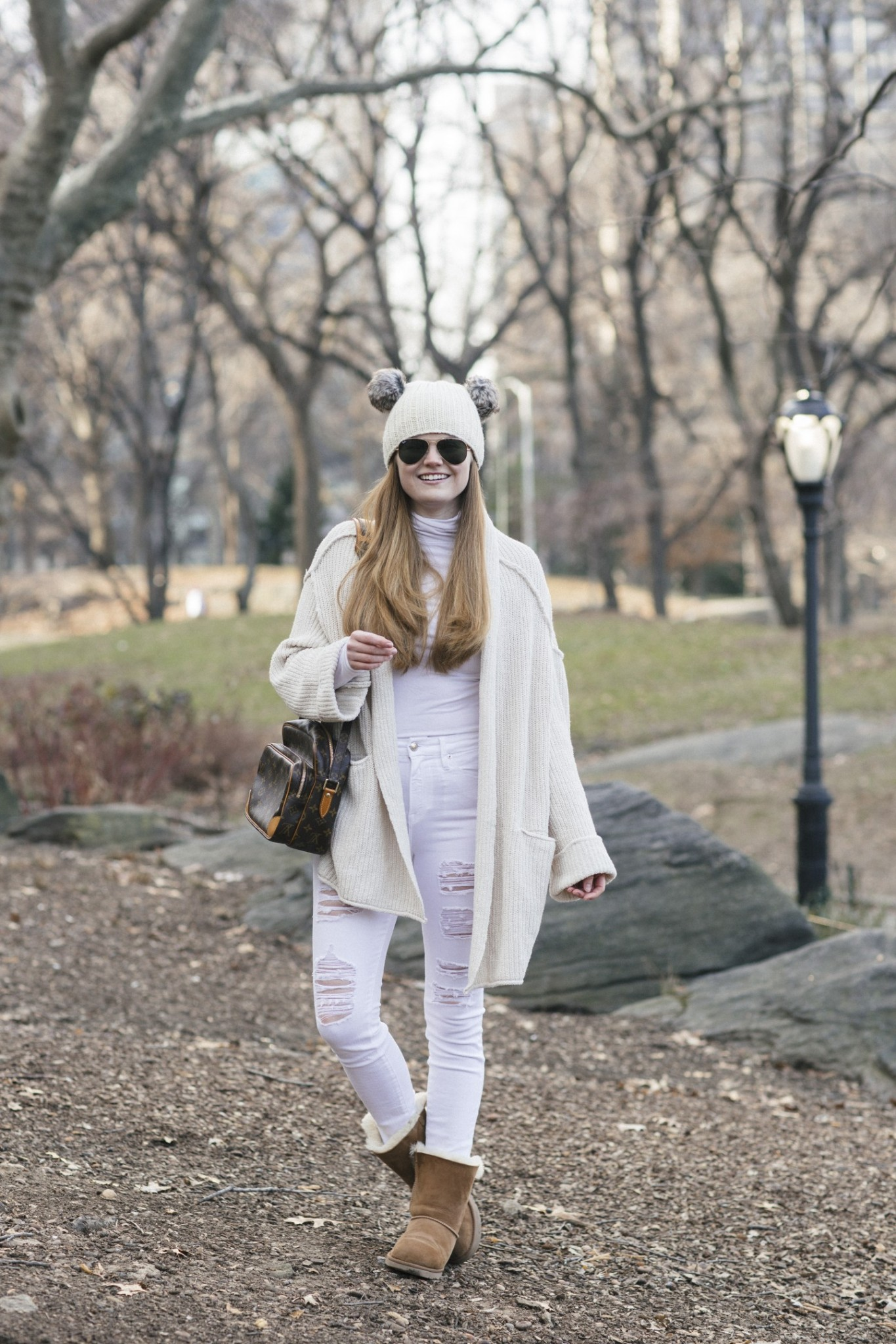 Lifestyle blogger Mollie Sheperdson shares a Winter White look in the Free People Low Tide Cardigan | Cozy Winter White Outfit featured by top London fashion blog, Mollie Moore