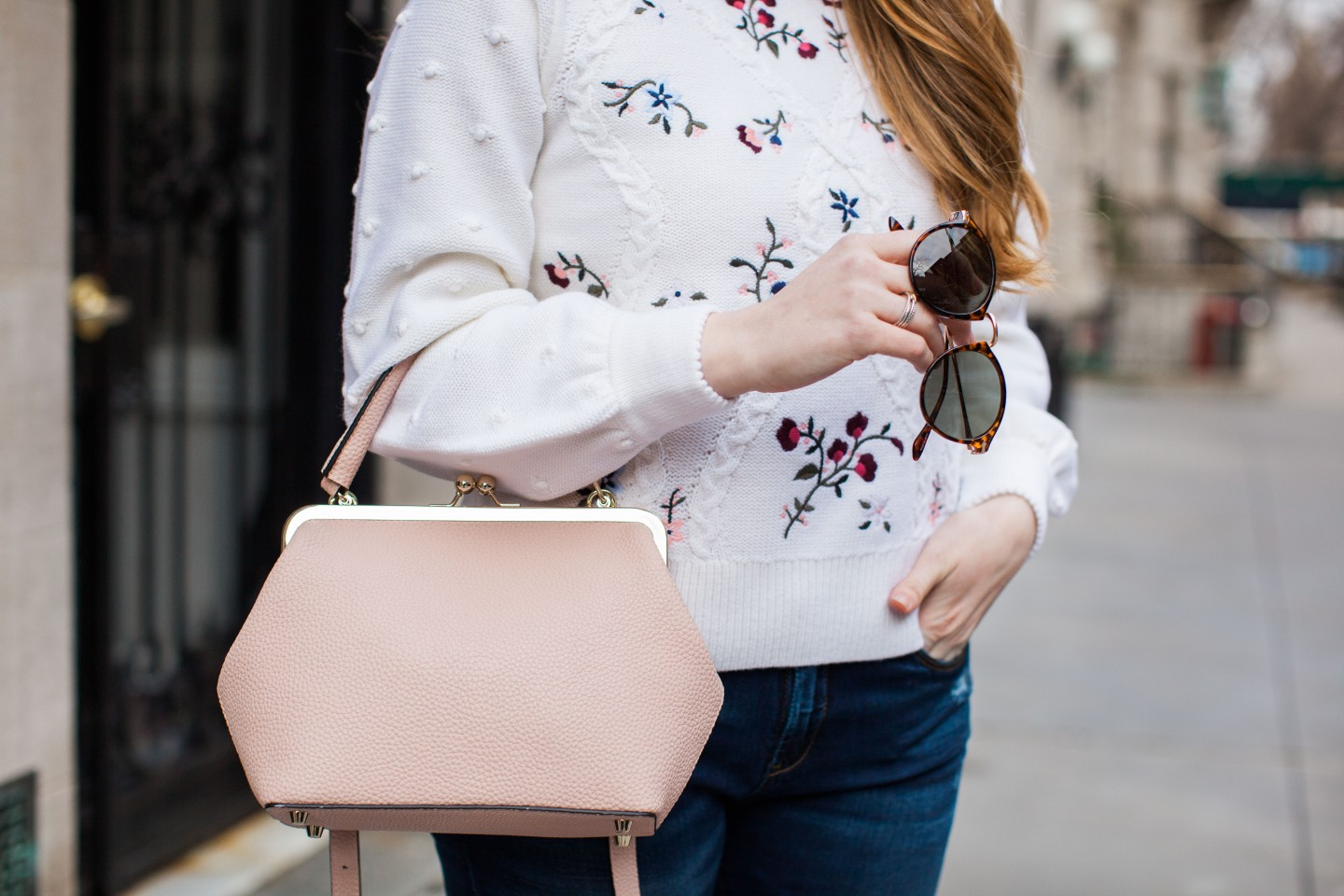 Lifestyle blogger Mollie Sheperdson style her favorite floral embroidered sweater from Club Monaco