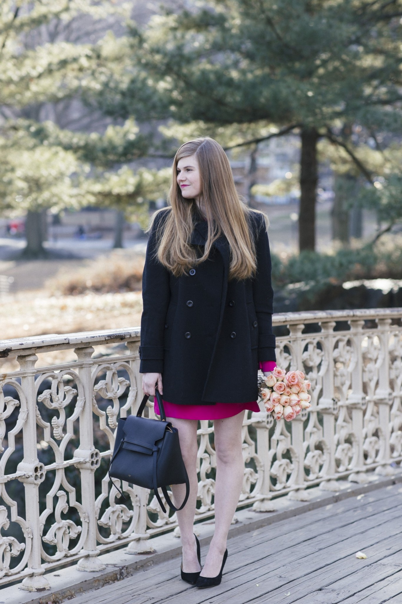 Lifestyle blogger Mollie Sheperdson shares a Valentine's Day date night outfit | Valentine's Day Date Night Look styled by top US fashion blogger, Mollie Moore: image of a woman wearing a Charles Henry Fit & Flare dress, Thread&Supply peacoat, Celine Belt Bag, Hazel pumps and Ray-Ban aviators sunglasses
