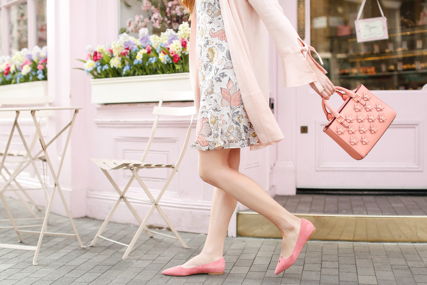 Floral Flounce Dress featured by top London fashion blogger Mollie Moore; Image of a woman wearing LOFT floral dress, LOFT cardigan, Sam Edelman flats and BP sunglasses.