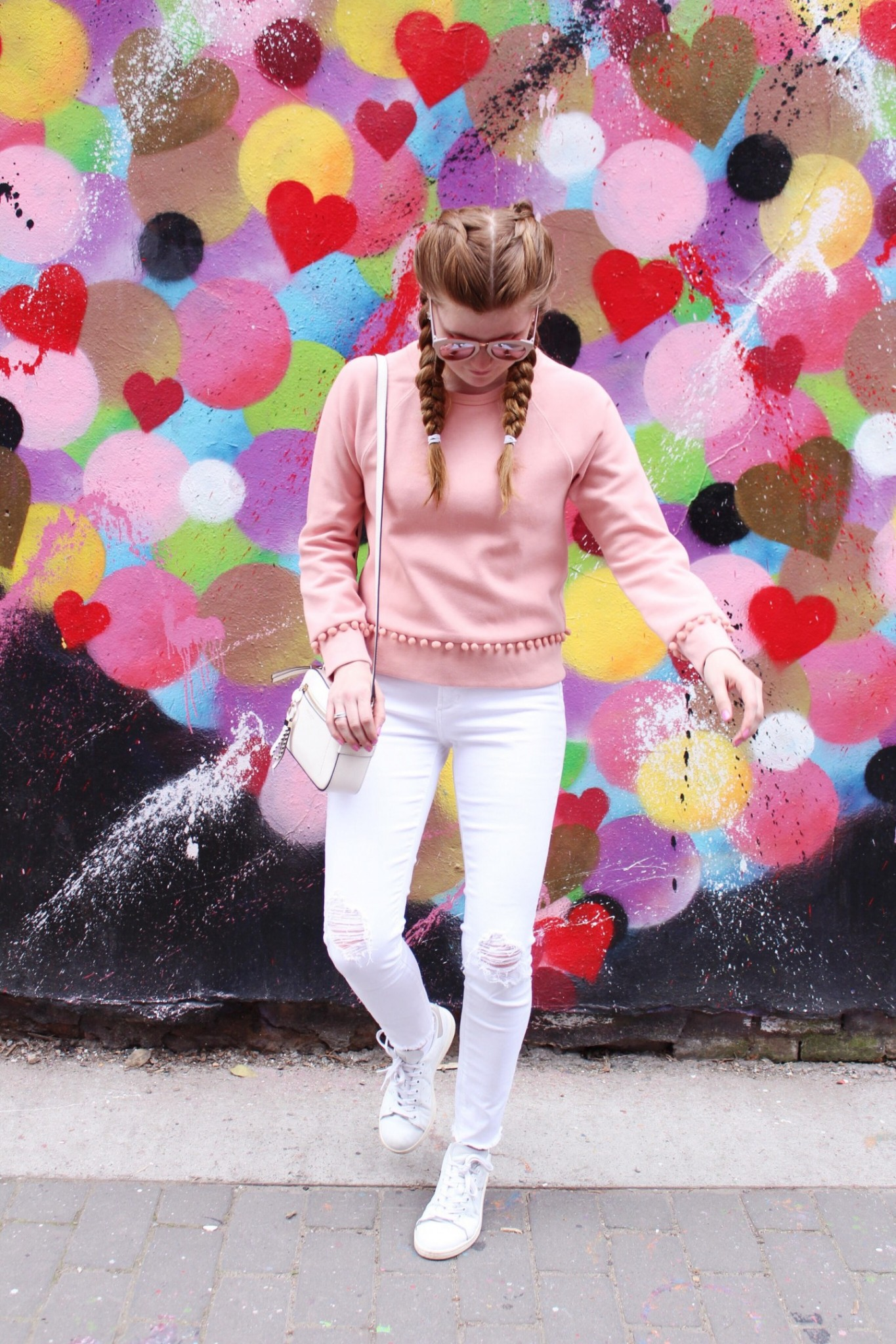 Lifestyle blogger Mollie Sheperdson shares a fun spring look in front of the Heart Wall in NYC