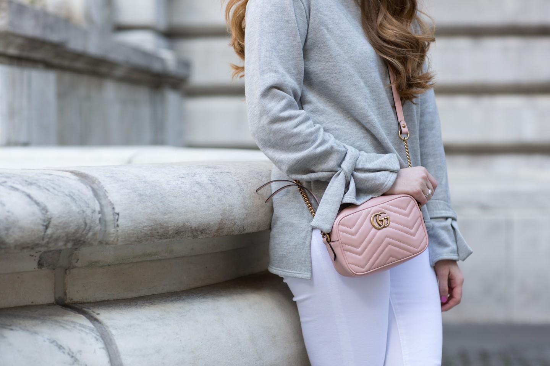 Lifestyle blogger Mollie Sheperdson styles a grey tie sleeve sweatshirt