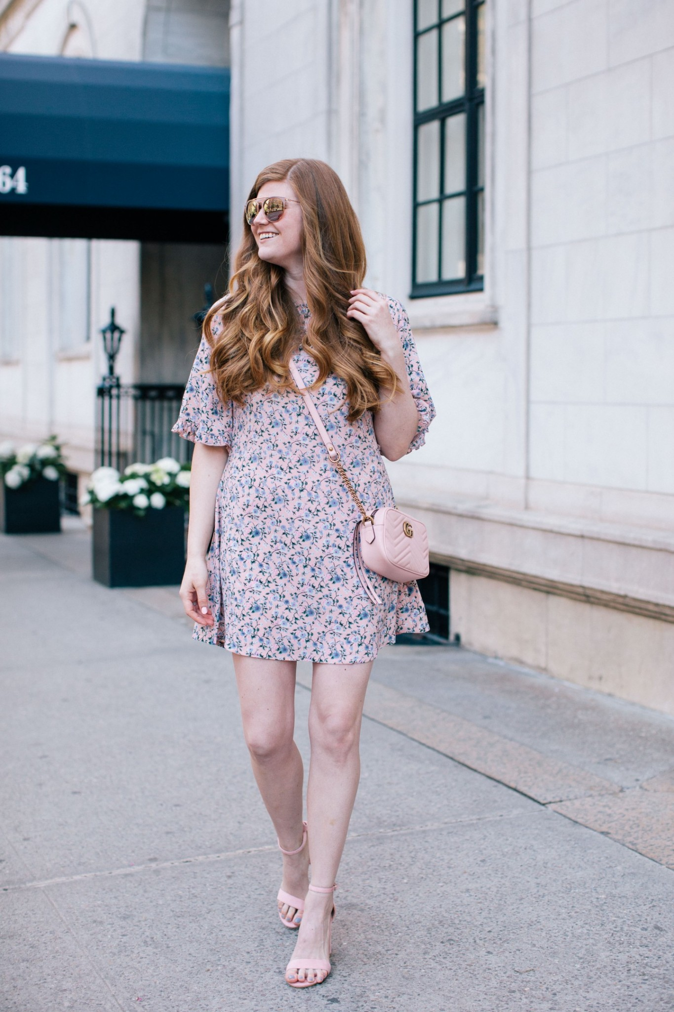 Spring Style featured by top London fashion blogger Mollie Moore; Image of a woman wearing Boohoo dress, Boohoo cardigan, Boohoo heels, Gucci bag and BP sunglasses.