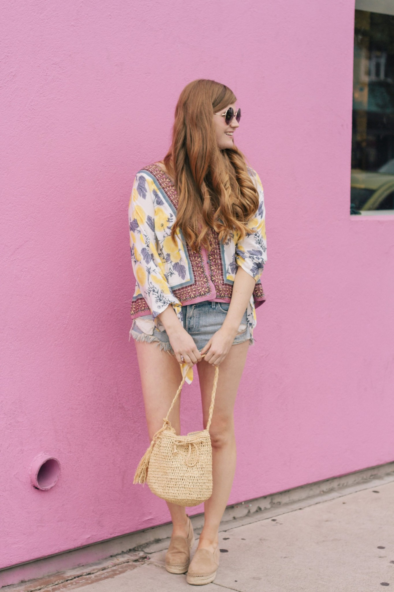 Lifestyle blogger Mollie Sheperdson styles a Free People lemon print top in West Hollywood