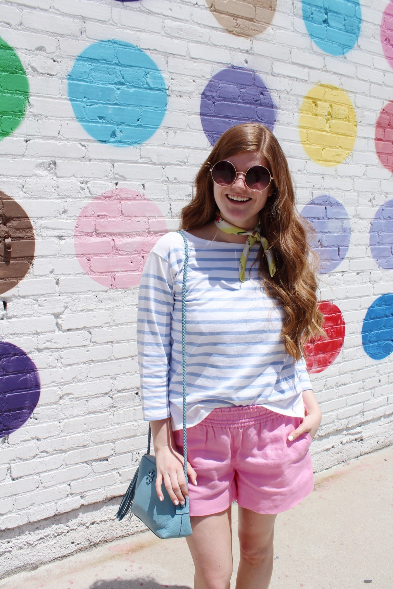 Lifestyle blogger Mollie Sheperdson styles a look at the Polka Dot Wall in LA
