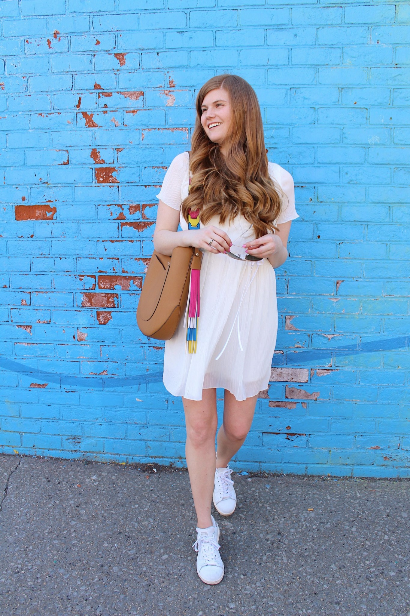 Popular London Life and style blogger Mollie Moore styles a summer outfit at the DUMBO Rainbow Wall