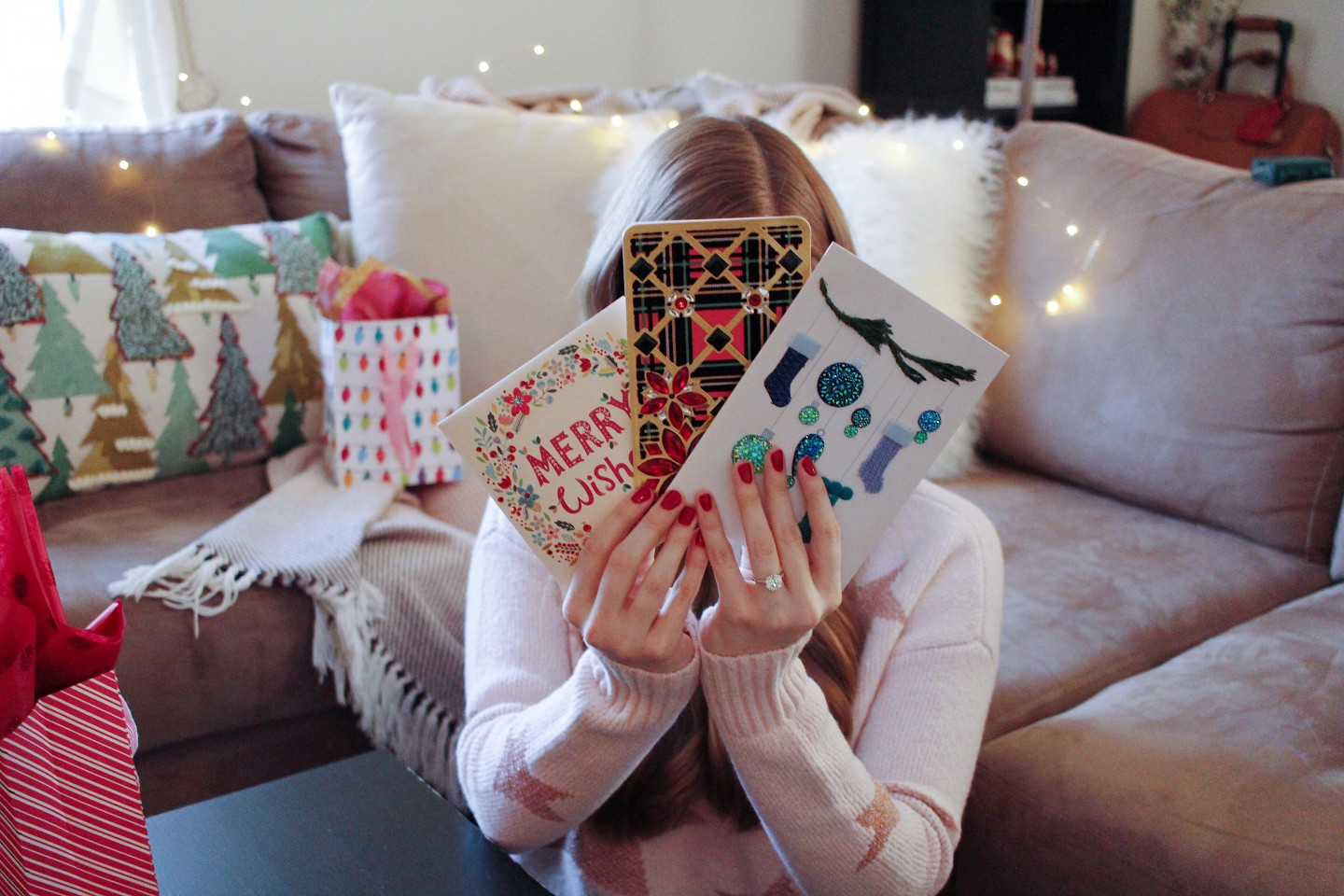 Papyrus Holiday Cards featured by top London life and style blogger, Mollie Moore: picture of a woman writing on her Papyrus Holiday Cards