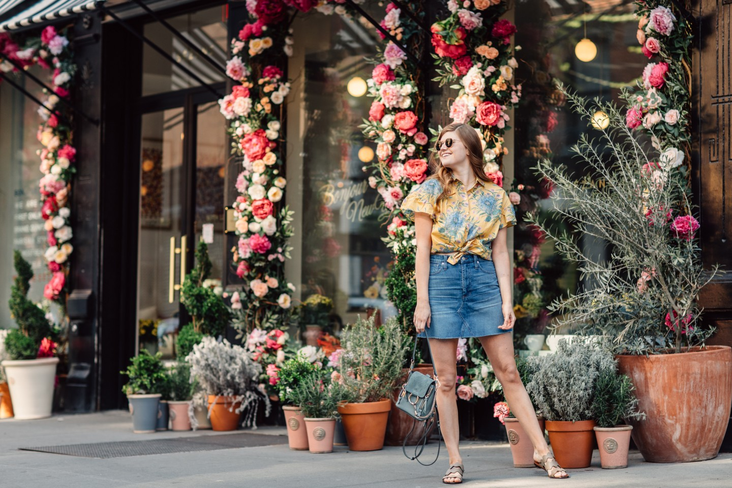 Lifestyle blogger Mollie Moore shares why you need a denim skirt this season | Denim Mini Skirt featured by top London fashion blog, Mollie Moore