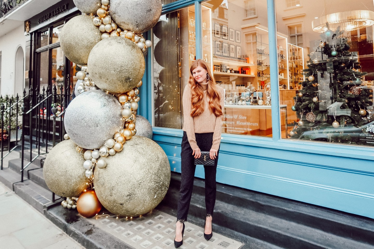 Lifestyle blogger Mollie Moore shares a holiday party outfit idea