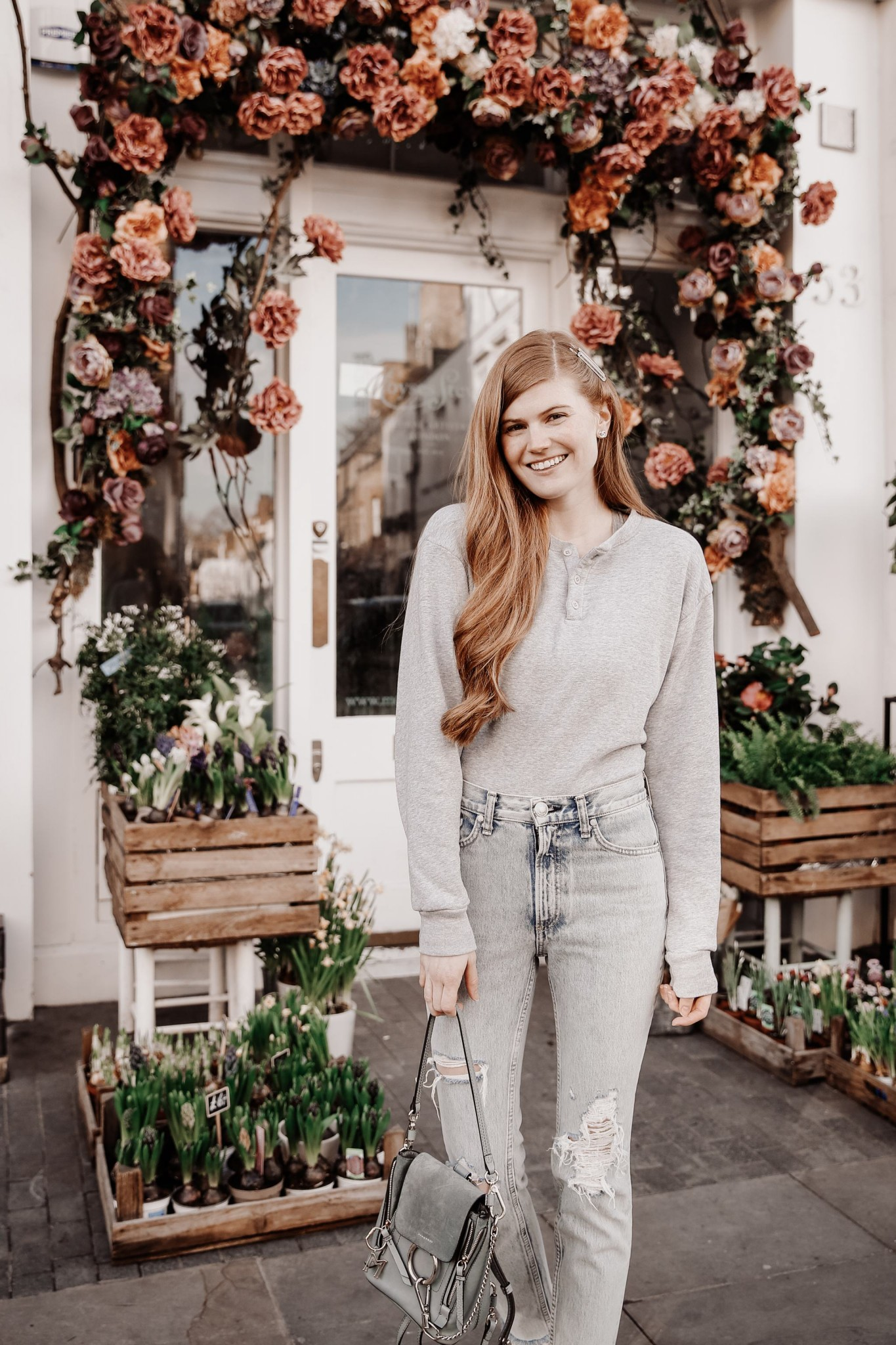 Golden Goose Sneakers featured by top UK fashion blogger Mollie Moore; Image of a woman wearing ZARA WOOL COAT, BRANDY MELVILLE CROPPED SWEATSHIRT, RAG & BONE DISTRESSED JEANS, CHLOE FAYE MINI BACKPACK, GOLDEN GOOSE SLIDE HIGH TOPS and ASOS HAIR CLIPS.