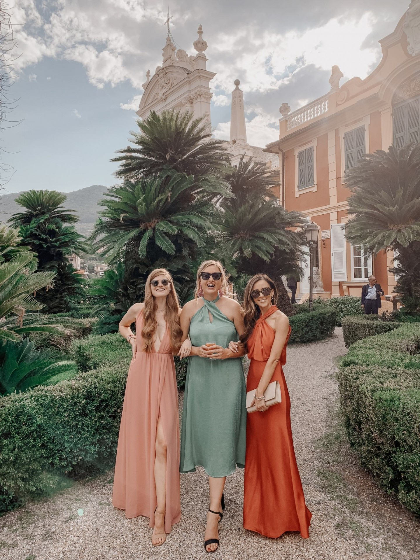 Lifestyle blogger Mollie Moore shares a Portofino Travel Guide | Travel Guide: Best Things to do in Portofino Italy by popular international travel blogger, Mollie Moore: image of three women standing together outside in Portofino Italy.