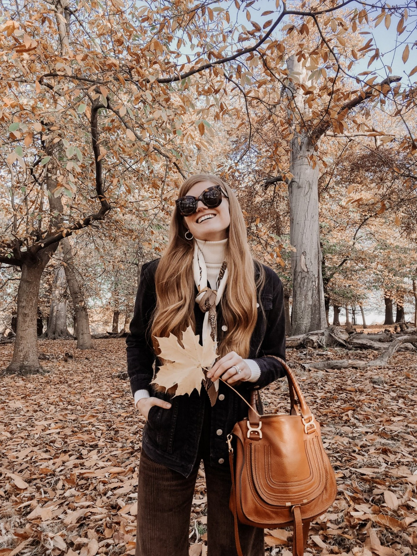 Lifestyle blogger Mollie Moore shares some autumn outfit inspo for 2019 | 5 Fall Fashion Outfits to Recreate This Season by popular fashion blogger, Mollie Moore: image of a woman outside wearing a Nordstrom McCoy Denim Jacket, Nordstrom Halogen Cashmere Turtleneck Sweater, Nordstrom Madewell Slim Emmett Wide Leg Crop Pants: Corduroy Edition, Nordstrom Chloe 'Medium Marcie' Leather Satchel, and Nordstrom Echo Heritage Chain Silk Scarf.