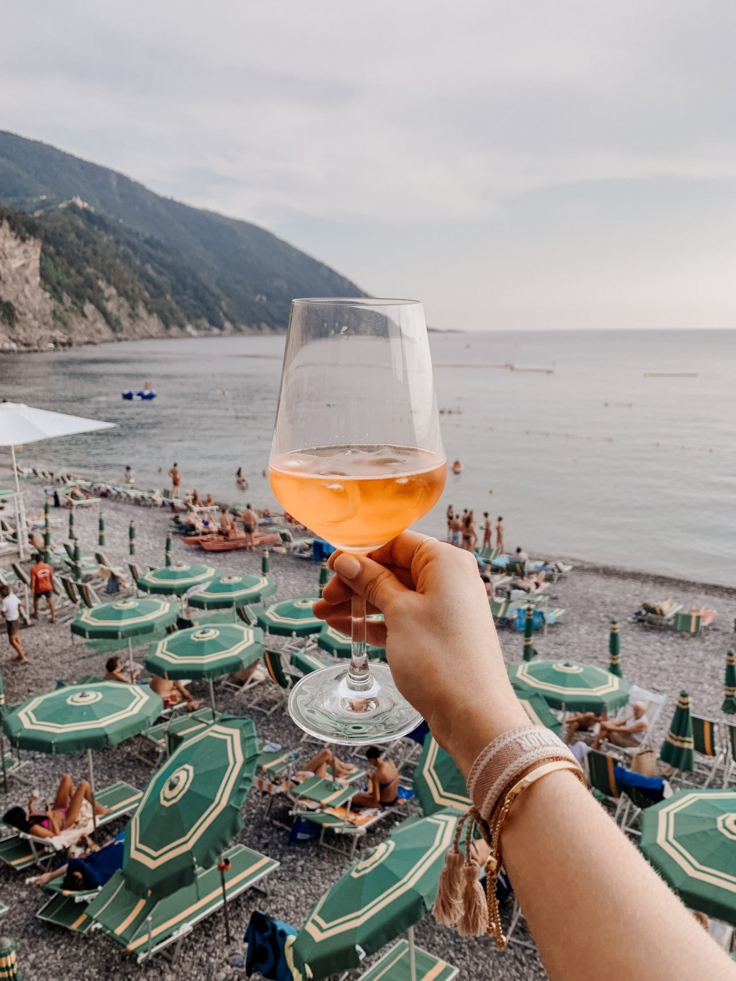 Lifestyle blogger Mollie Moore shares a Portofino Travel Guide | Travel Guide: Best Things to do in Portofino Italy by popular international travel blogger, Mollie Moore: image of a woman holding a cocktail.