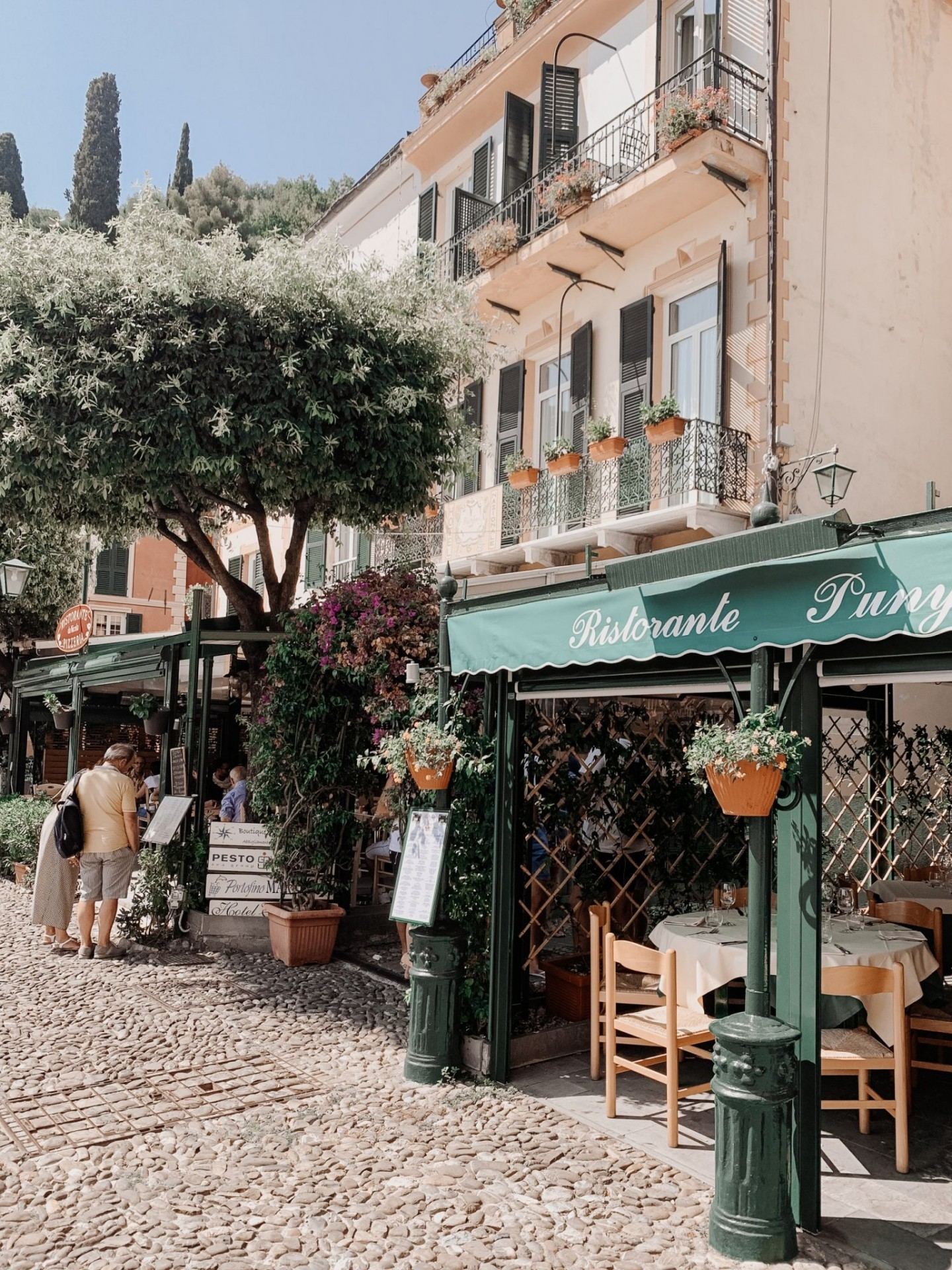 Lifestyle blogger Mollie Moore shares a Portofino Travel Guide | Travel Guide: Best Things to do in Portofino Italy by popular international travel blogger, Mollie Moore: image of a restaurant in Portofino Italy.