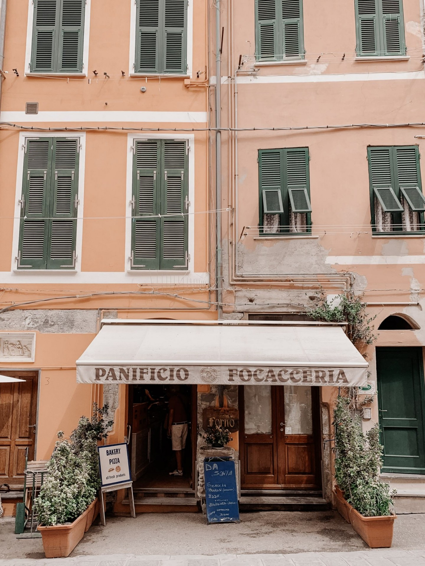 Lifestyle blogger Mollie Moore shares a Cinque Terre travel guide | Travel Guide: Things to do in Cinque Terre, Italy by popular London travel blogger, Mollie Moore: image of Panificio Focacceria in Cinque Terre, Italy.