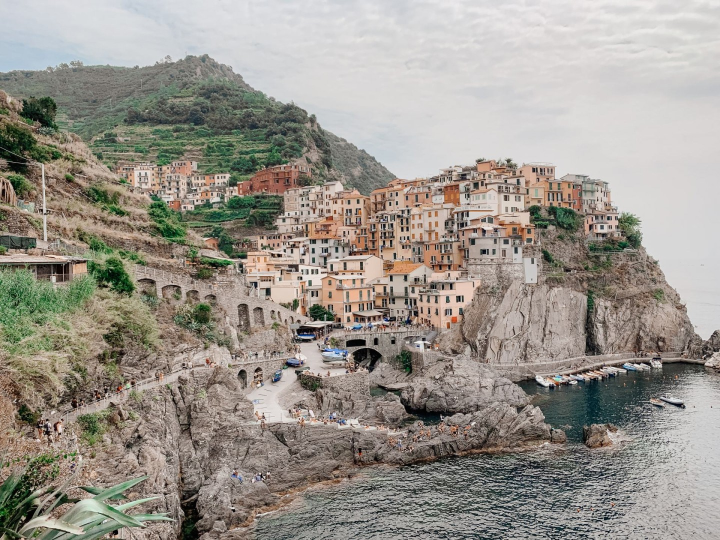 Lifestyle blogger Mollie Moore shares a Cinque Terre travel guide | Travel Guide: Things to do in Cinque Terre, Italy by popular London travel blogger, Mollie Moore: image of colorful buildings on a cliff in Cinque Terre, Italy.