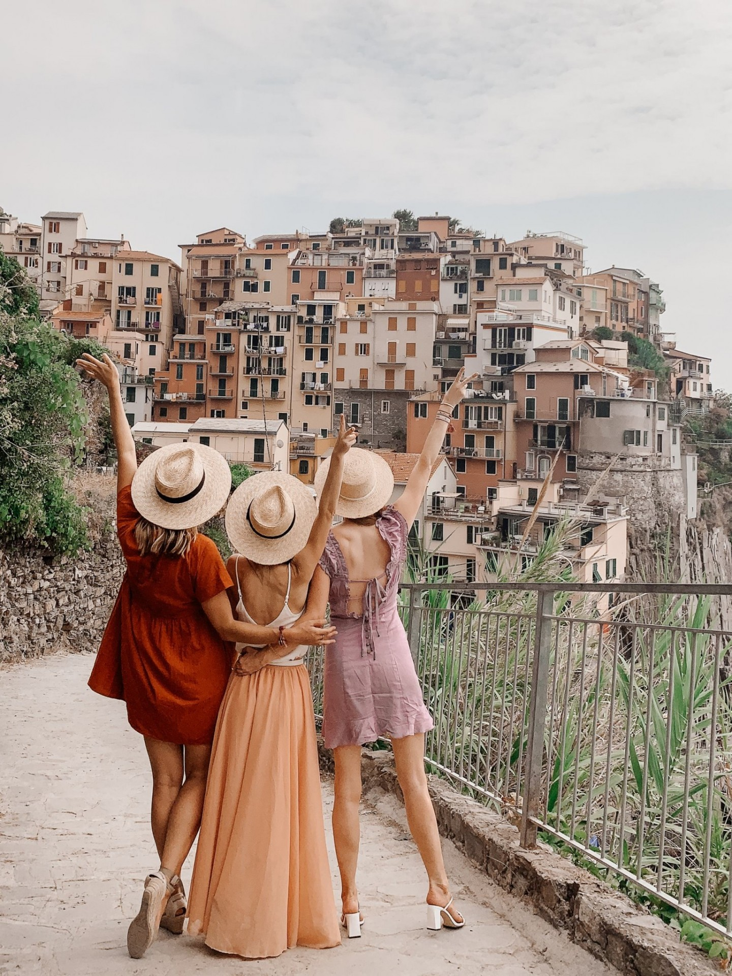 Lifestyle blogger Mollie Moore shares a Cinque Terre travel guide | Travel Guide: Things to do in Cinque Terre, Italy by popular London travel blogger, Mollie Moore: image of three women standing outside in Cinque Terre, Italy.
